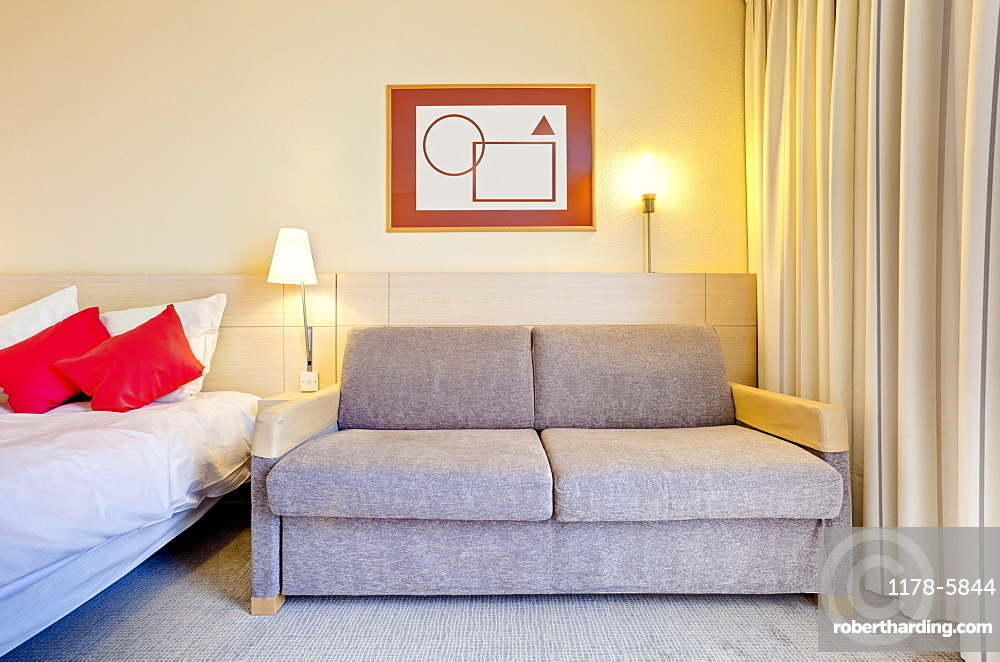 Sofa beside bed in luxury home