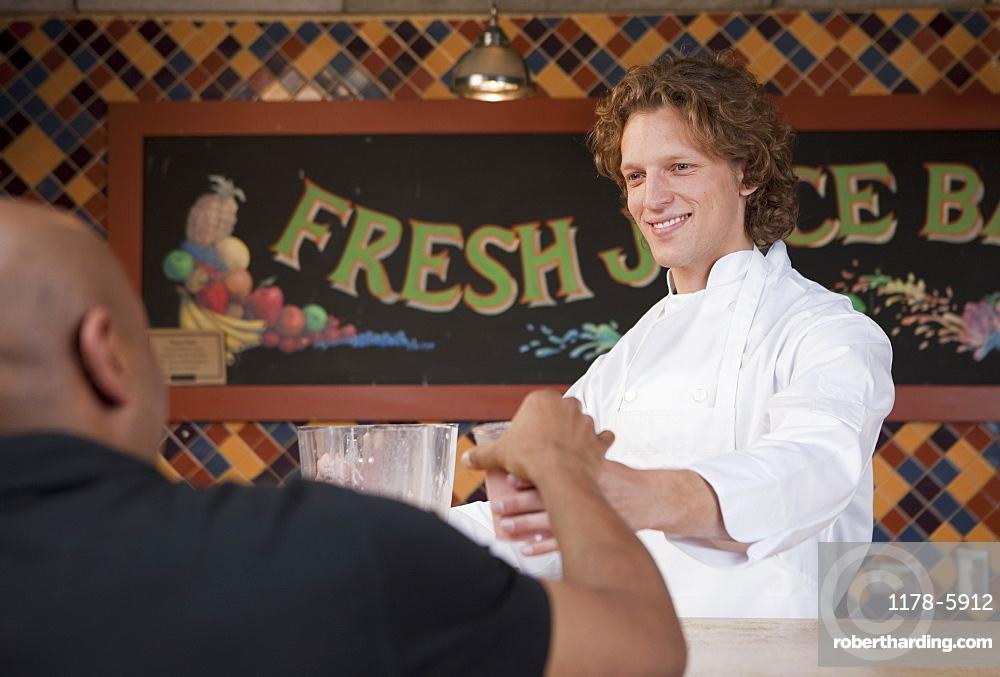 Bartender and customer at juice bar