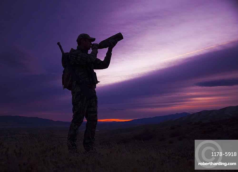 Big game hunter at dusk