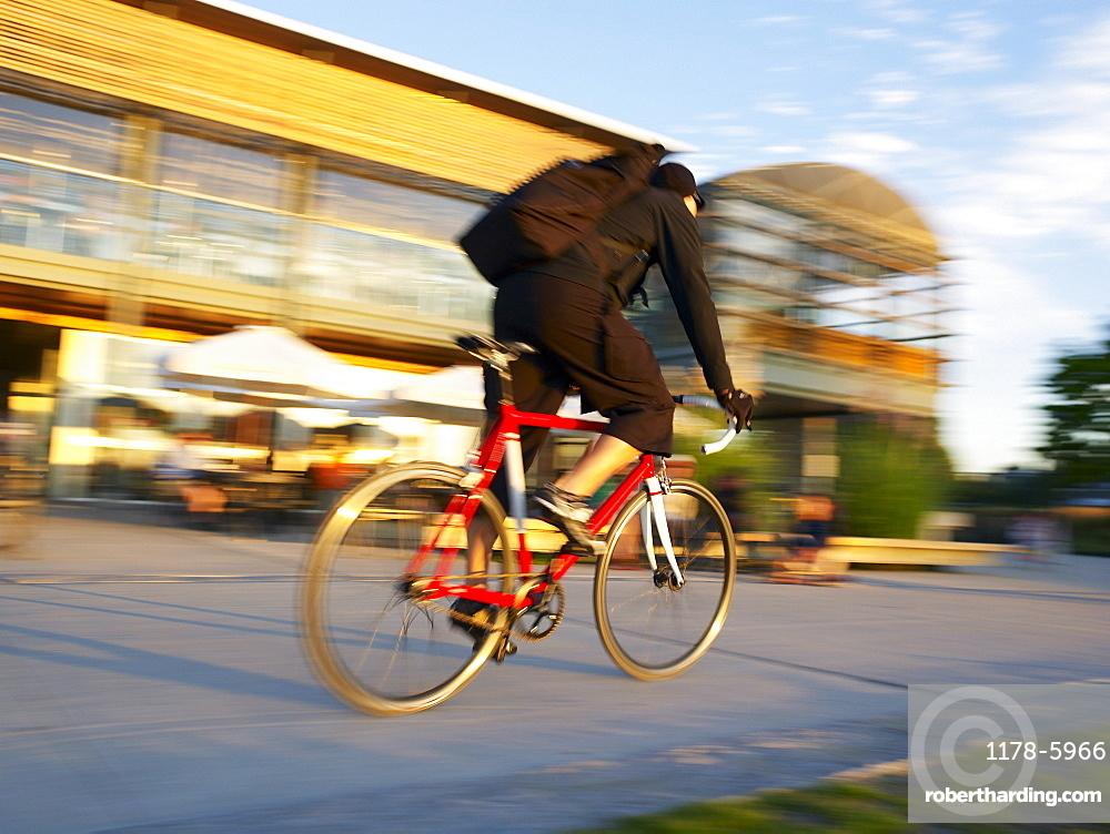 Cyclist riding bike on Vancouver street