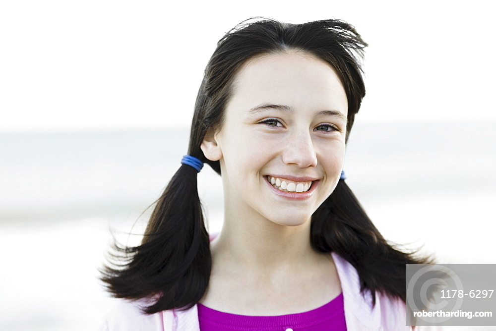 Young girl with pony tails