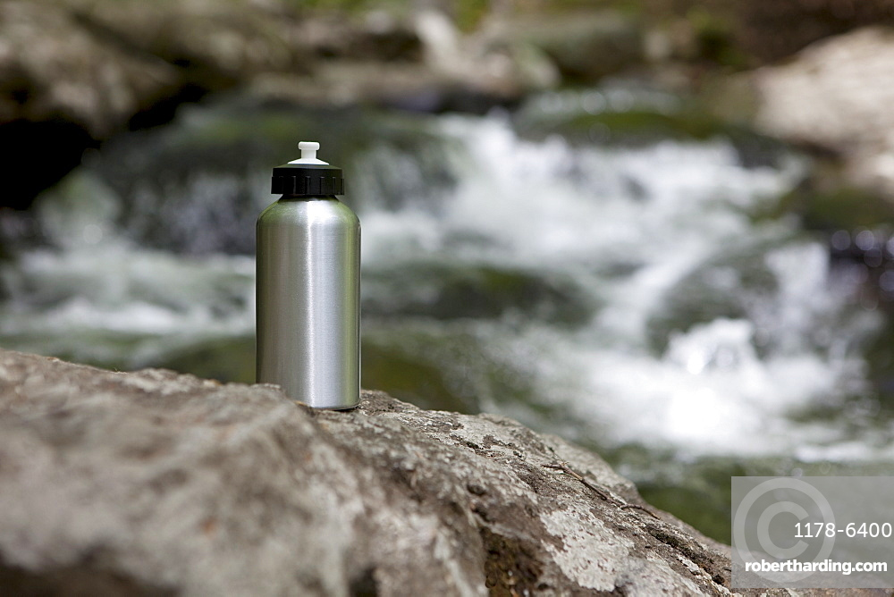 A reusable water bottle in the woods