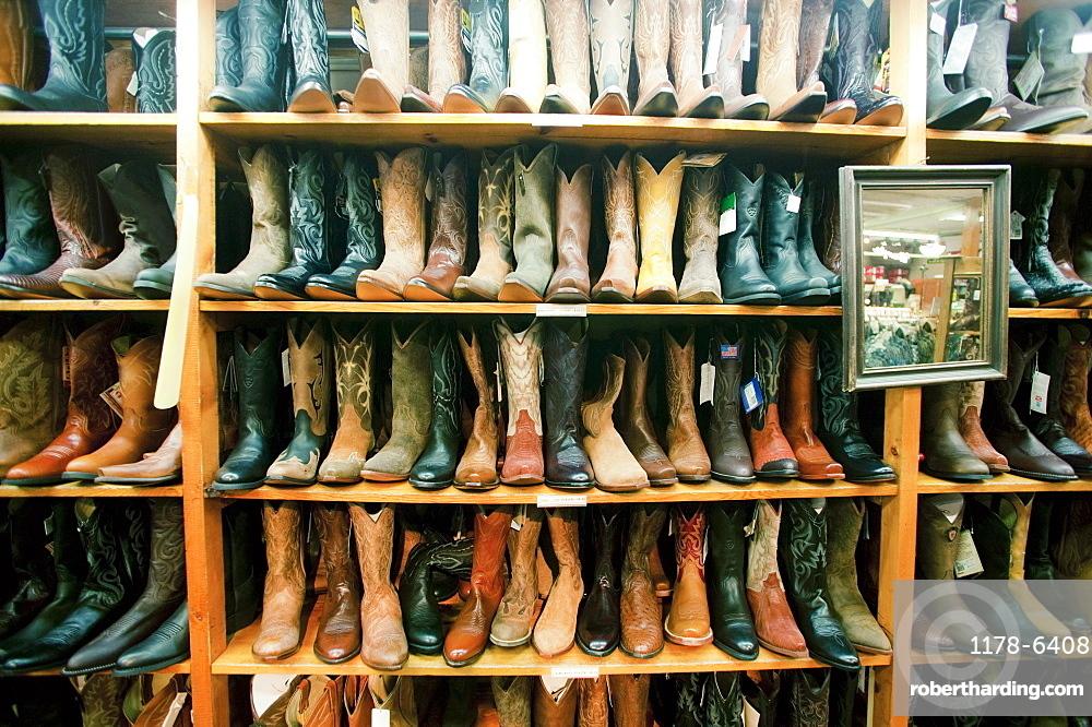 Boot in row on shelves in shop, Aspen, Colorado, USA
