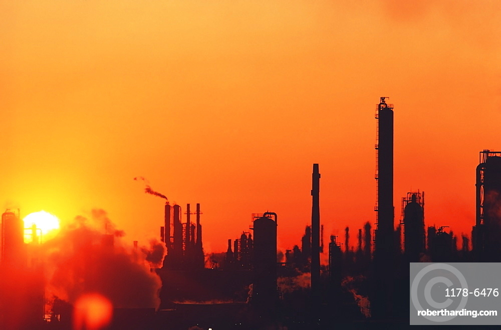 Sun setting on oil refinery in Baytown, Texas