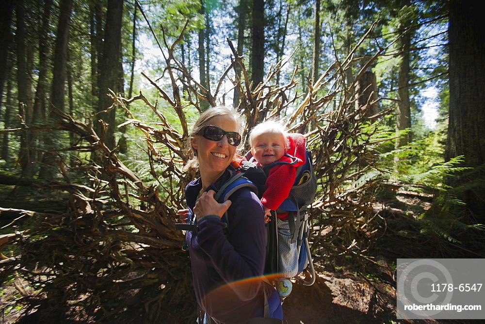 Woman with son (4-5) on trail of cedars, Trail of the cedars,Glacier National Park, Montana, USA