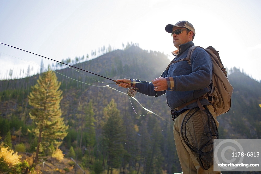 Fisherman in front of mountain, Montana, USA