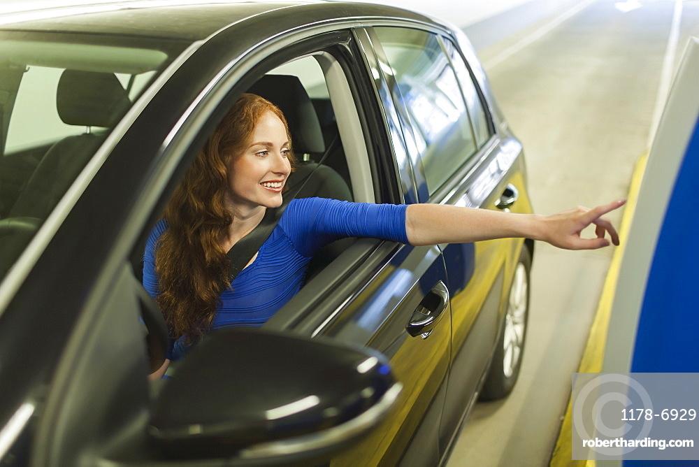 Young woman parking car