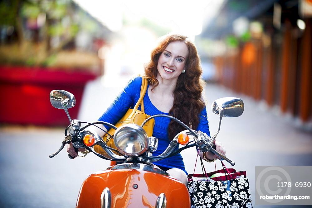 Elegant woman on motorcycle, Goirle