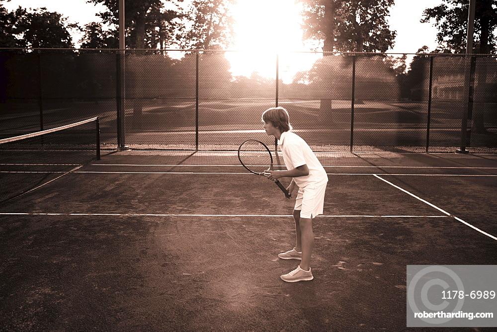 Boy playing tennis, Texarkana, AR