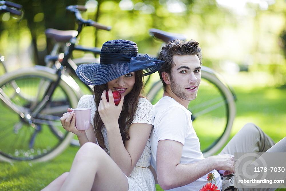 Couple having picnic in park, Netherlands, Oisterwijk