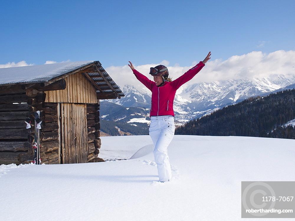 Austria, Maria Alm, Woman at top of mountain spreading arms, Austria, Maria Alm