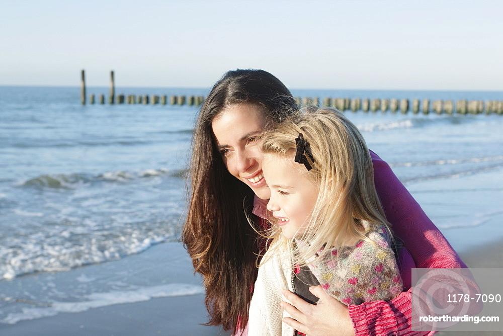 Netherlands, Zeeland, Haamstede, Mother with daughter on beach, Netherlands, Zeeland, Haamstede