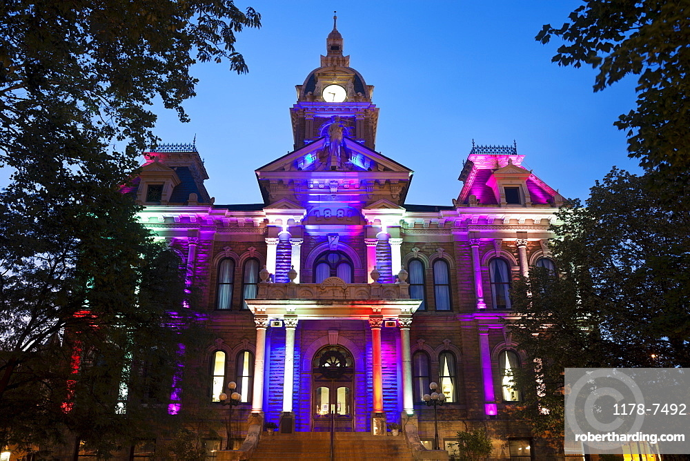 USA, Ohio, Cambridge, Town hall with colorful lights at dusk