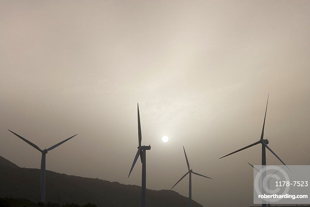 Silhouettes of wind turbines