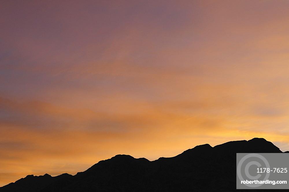 USA, California, Silhouette of ridge at sunset