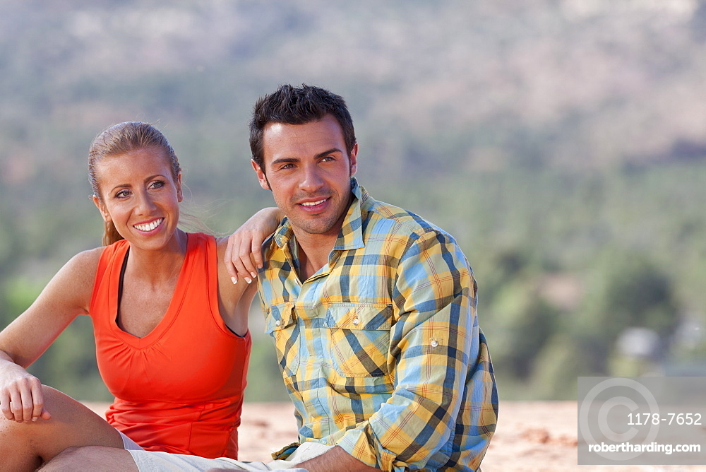 USA, Arizona, Sedona, Young couple enjoying view in desert after hiking