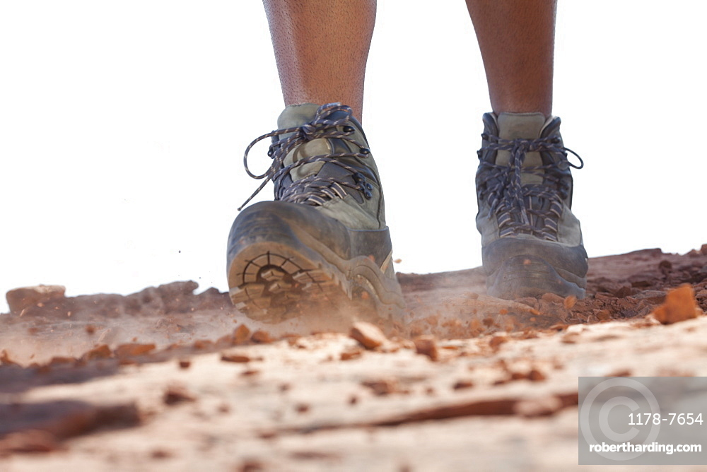 Hiking boots moving across rocky surface