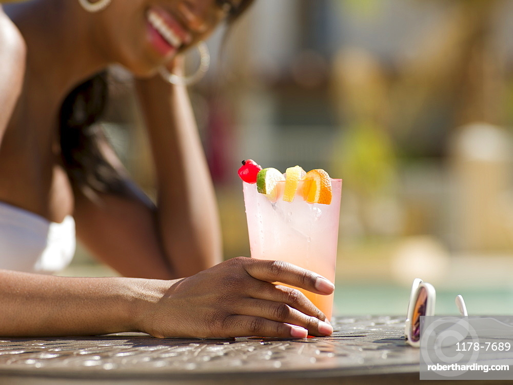 Young woman at pool side bar