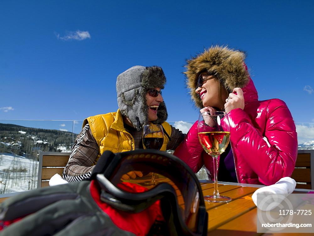 USA, Colorado, Telluride, Couple enjoying outdoor meal at ski resort