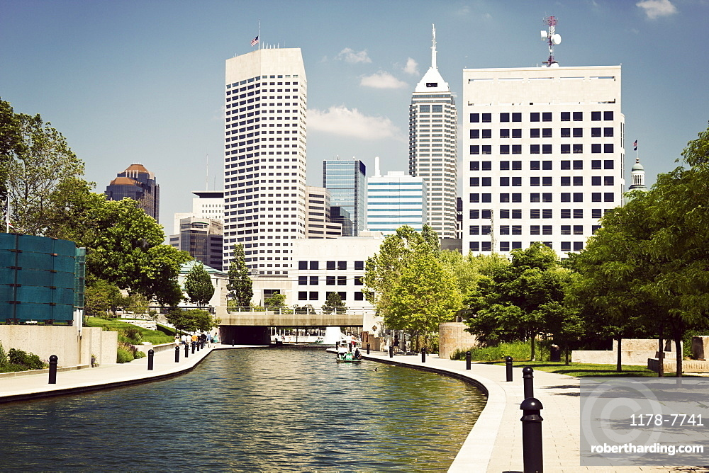 USA, Indiana, Indianapolis, View of canal and skyscrapers