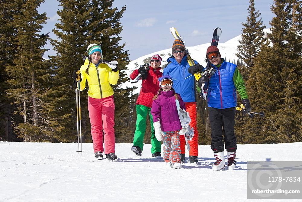 USA, Colorado, Telluride, Three-generation family with girl (10-11) posing during ski holiday