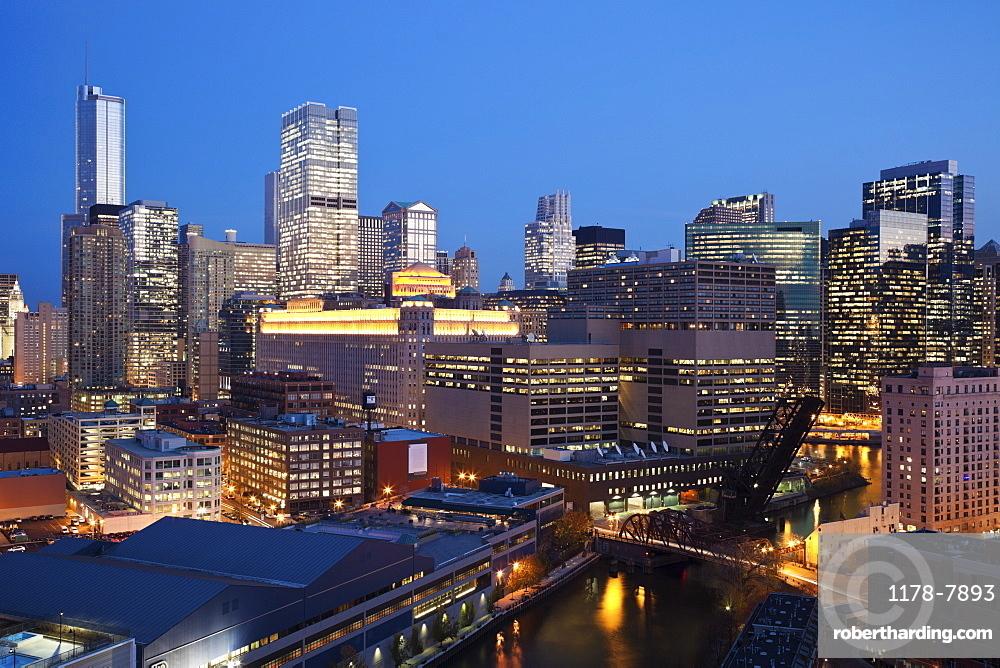USA, Illinois, Chicago, Skyline and river illuminated at night
