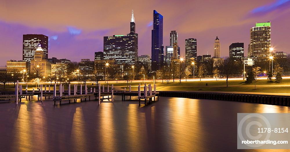USA, Illinois, Chicago, City skyline and marina illuminated at dusk