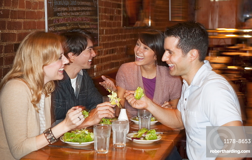 Friends eating at restaurant