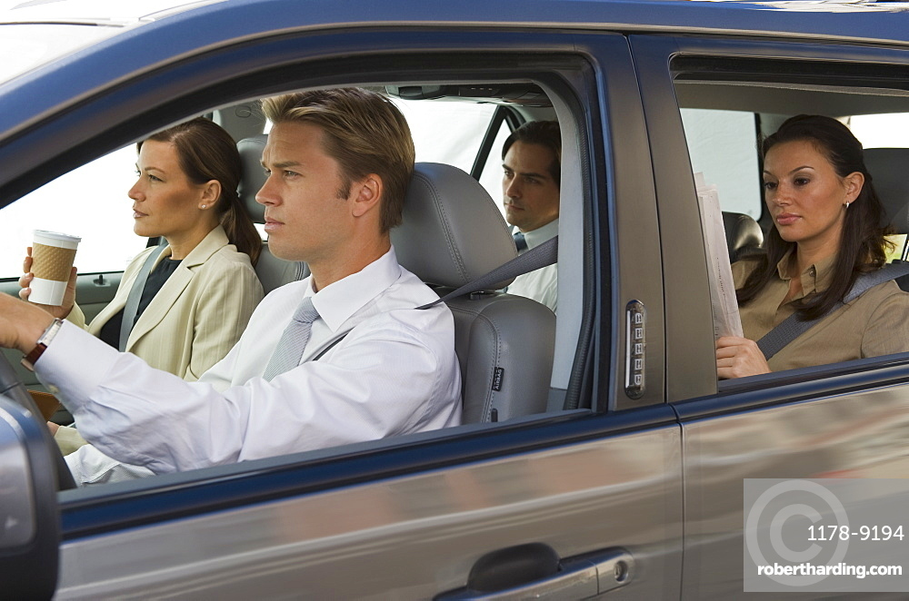 Business people car pooling