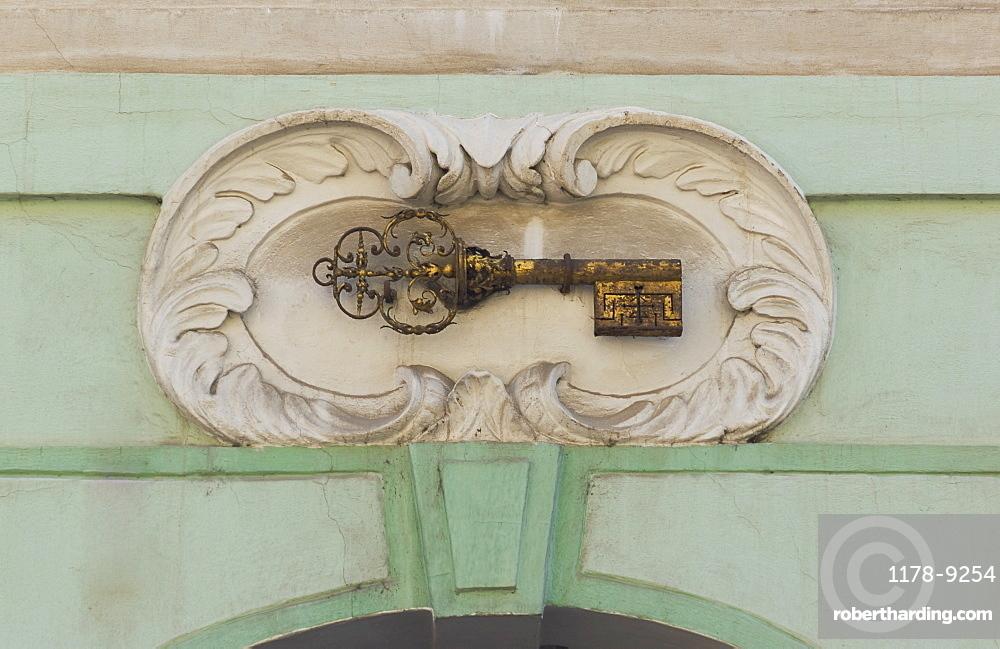Gold key plaque to identify house, Prague