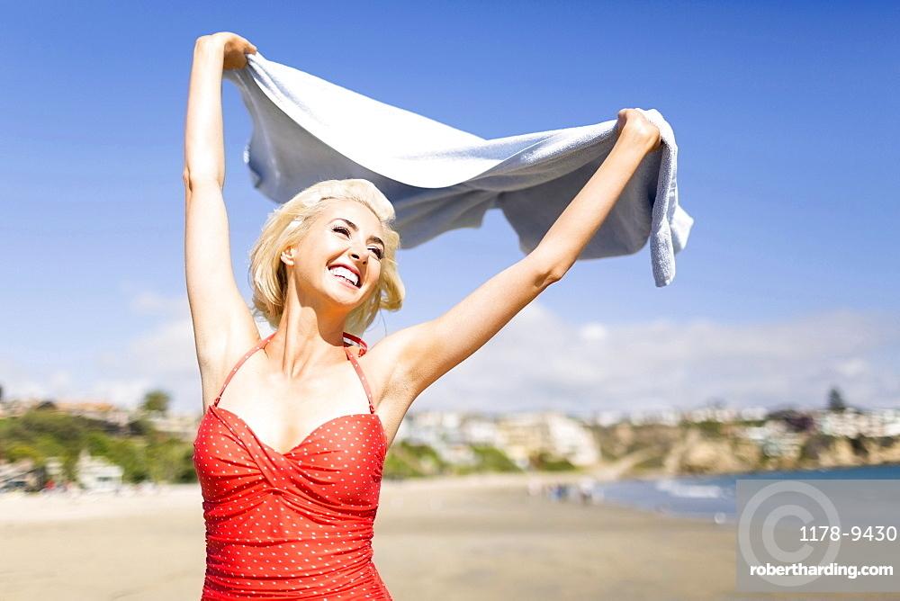 Portrait of blond woman on beach, Costa Mesa, California