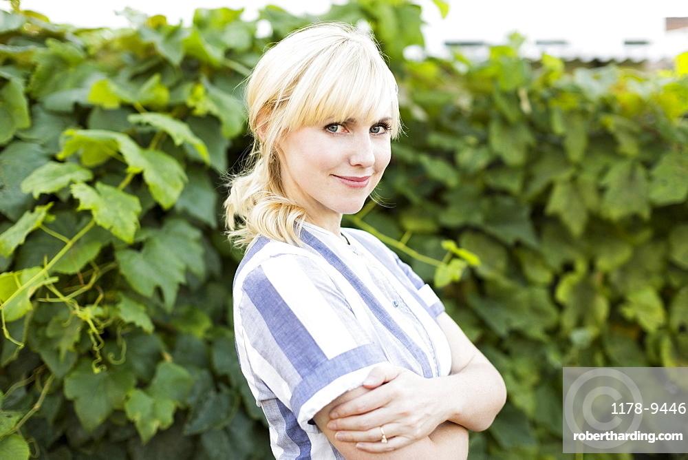 Portrait of blond woman in back yard