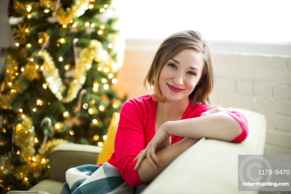 Portrait of young woman relaxing at Christmas time