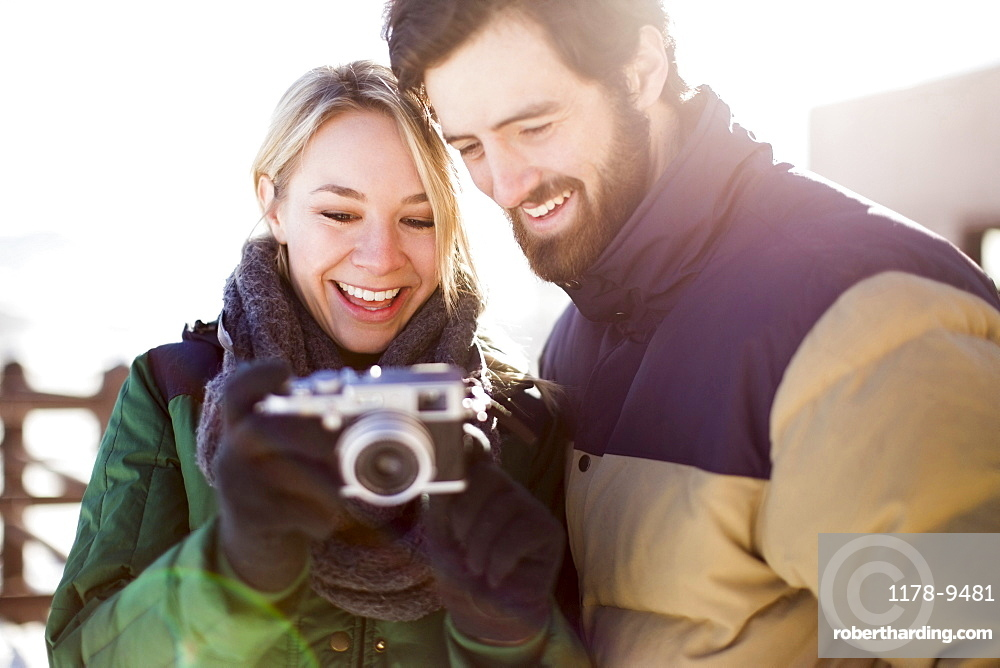 Couple looking at old-fashioned camera
