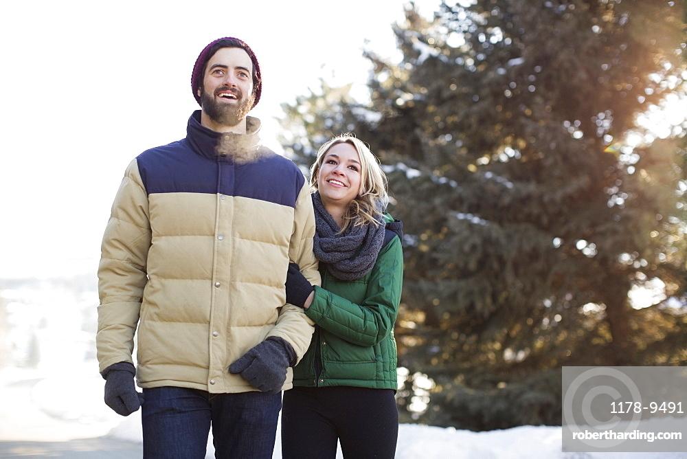 Couple walking in winter landscape, Salt Lake City, Utah
