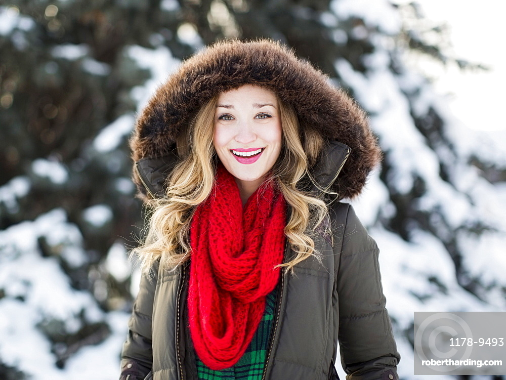 Portrait of woman wearing red scarf smiling outdoors, Salt Lake City, Utah
