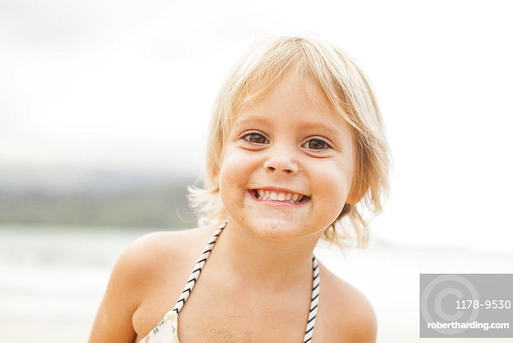Baby girl (2-3) on beach, Kauai, Hawaii