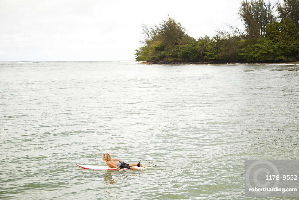 Boy (6-7) surfing, Kauai, Hawaii