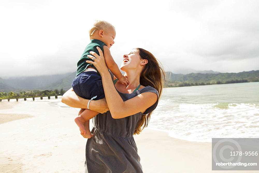 Young mother with baby daughter (6-11 months), Kauai, Hawaii