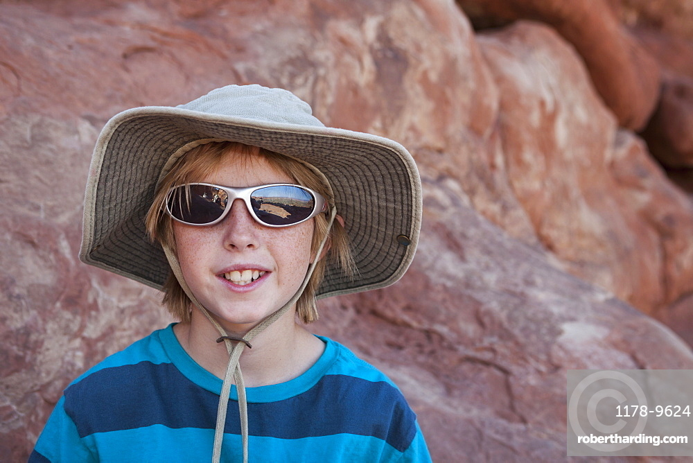 Young boy (10-11) hiking, USA, Utah, Arches National Park, Moab