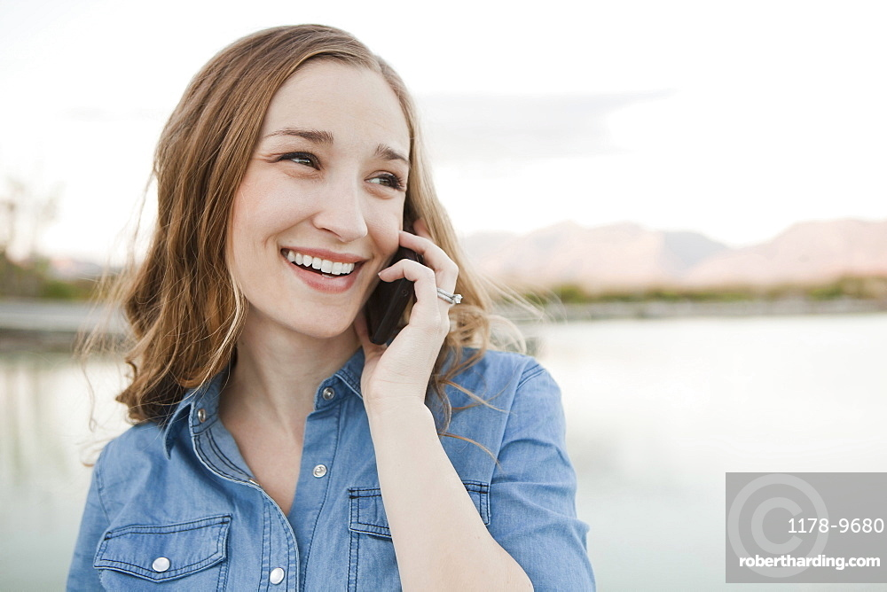 Portrait of young woman talking on phone, Salt Lake City, Utah