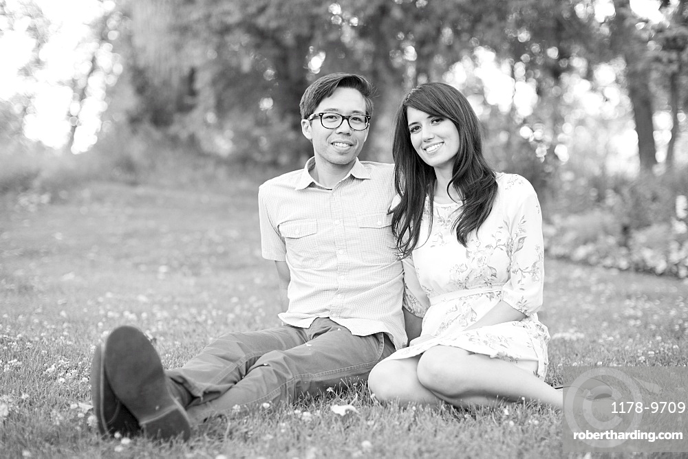 Portrait of couple relaxing in park, Salt Lake City, Utah