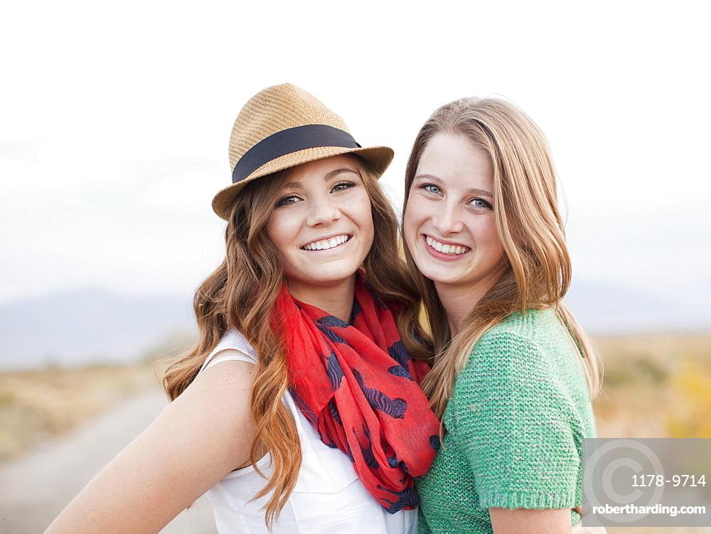 Portrait of two young women cheek to cheek, Provo, Utah