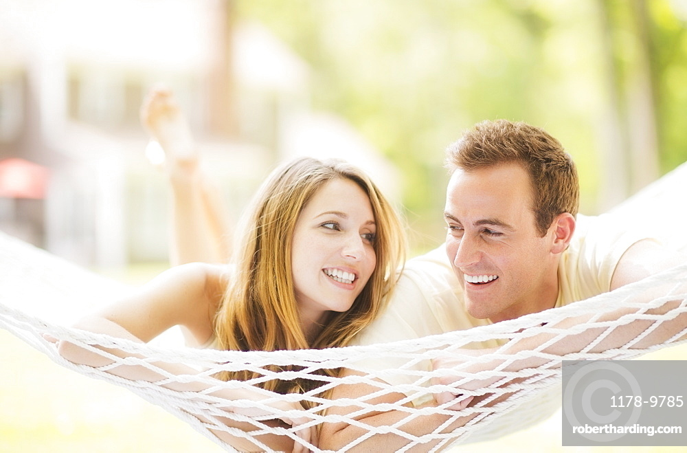 Couple relaxing in hammock, USA, New Jersey, Mendham