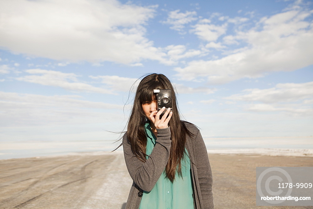 USA, Utah, Salt Lake City, Young woman taking photos, USA, Utah, Salt Lake City