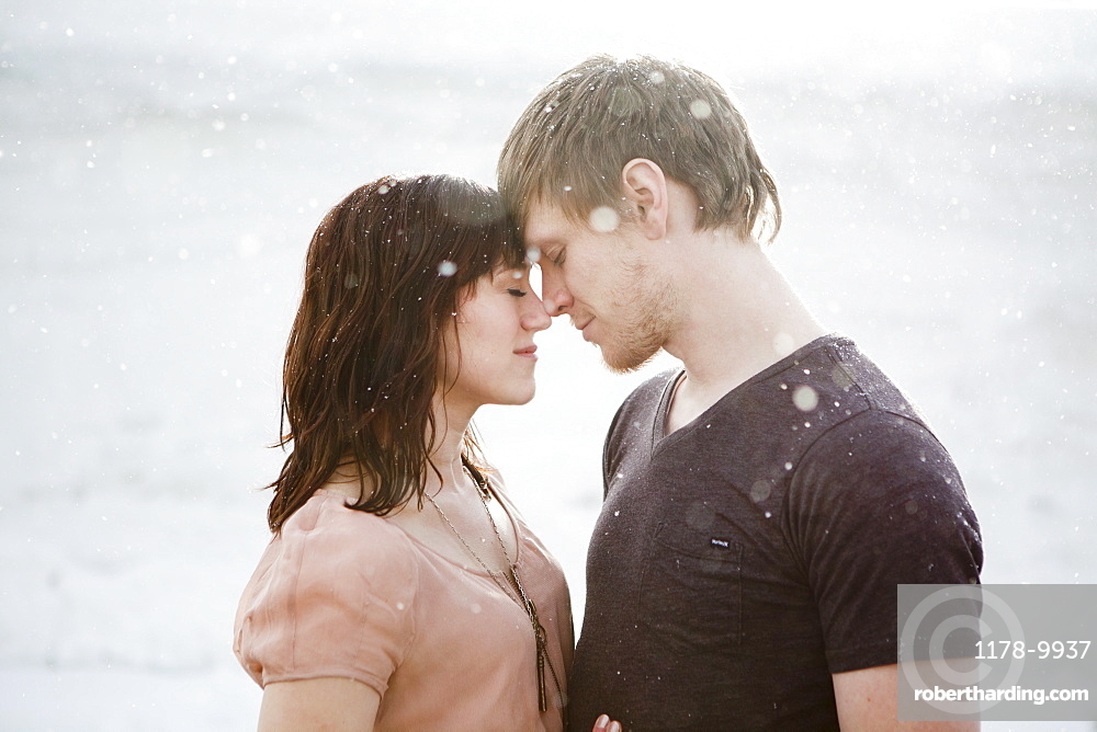 Young couple embracing in rain