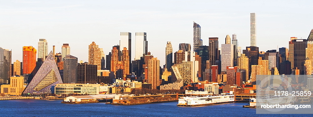 USA, New York State, New York City, Waterfront skyline at sunrise