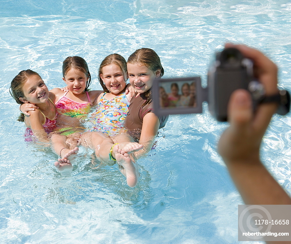 Girls being videotaped in swimming pool