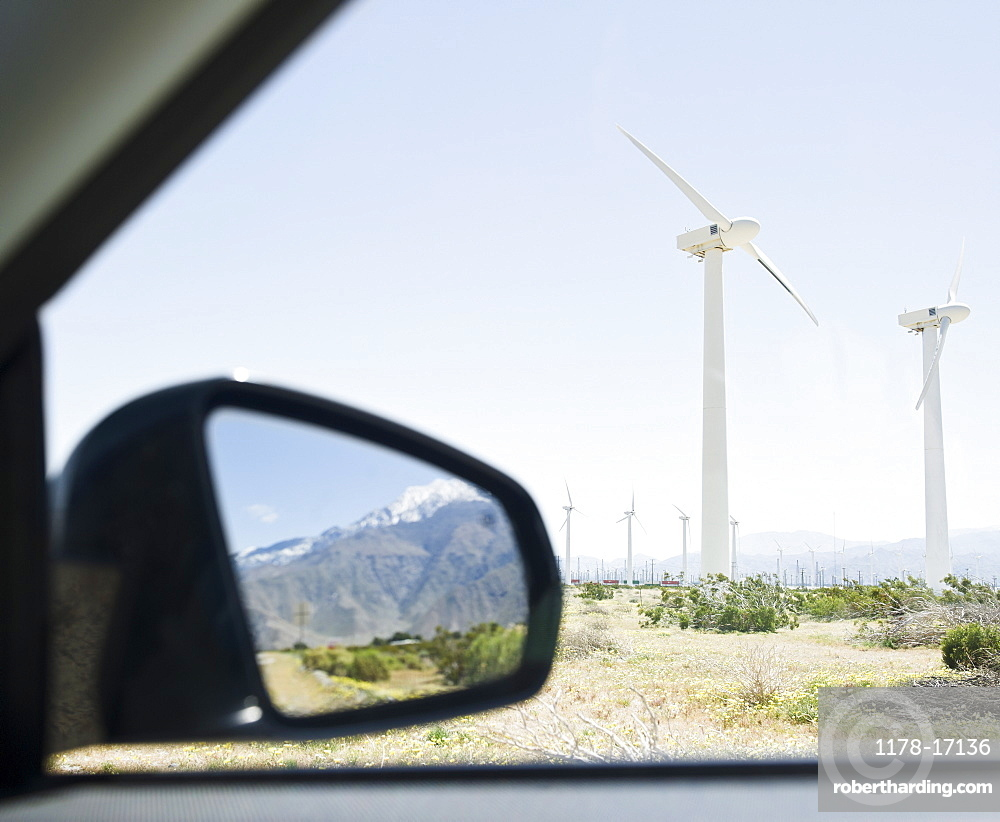 USA, California, Palm Springs, Coachella Valley, San Gorgonio Pass, Mountains reflecting in rear- view mirror with wind turbines in background