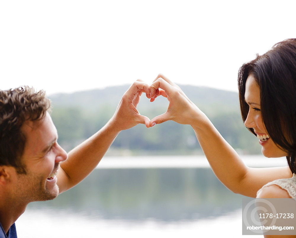 Roaring Brook Lake, Couple making heart shape with hands